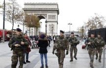 Soldiers patrol in front of the Arc de Triomphe on the Champs Elysees in Paris, France, November 16, 2015, as security increases after last Friday's series of deadly attacks in the French capital.