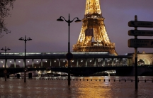 A view shows the flooded banks of the Seine River and the Eiffel Tower.