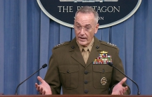 US Joint Chiefs of Staff Chairman General Joseph Dunford is stands at a podium during a press conference.