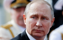 A close up photograph of Russian President Vladimir Putin