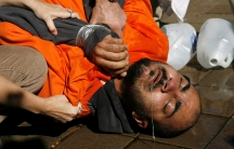 A demonstrator is held down during a simulation of waterboarding outside the Justice Department in 2007.