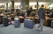 A passenger looks for his displaced or lost luggage at the international airport in Vancouver, British Columbia.