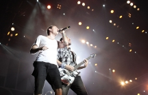 Linkin Park's frontman Chester Bennington (L) and Mike Shinoda perform at a concert in Shanghai August 15, 2009.