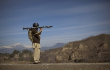 Pakistani soldier holds a rocket launcher.