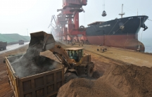 Iron ore is unloaded from the Star Fortune bulk carrier at Rizhao Port, one of China's biggest ports for importing the commodity, in Shandong province, in March 2010.