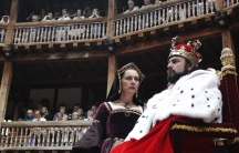 Actors Dominic Rowan (R) and Kate Duchene perform as Henry VIII and Queen Katherine in Shakespeare's Henry VIII at the Globe theatre in London July 6, 2010.