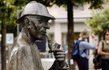 "A life-size bronze figure of British author Arthur Conan Doyle's character, the detective Sherlock Holmes is pictured on the main square in the town of Meiringen, Switzerland. Meiringen was the location of ""The Adventure of the Final Problem"" in which, wr"
