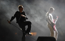 Bono and Adam Clayton of U2 performing in Mexico City in 2011