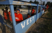 Members of the Longhorns compete in a Friday night softball game in West Liberty, Iowa