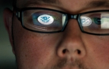 A cyber security analyst works in a watch and warning center at a Department of Homeland Security cyber security defense lab at the Idaho National Laboratory.