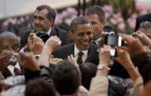 U.S. President Barack Obama greets an adoring crowd in Cannes, France on November 4, 2011.