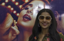 """Bollywood actress Vidya Balan smiles during a news conference to promote her 2011 movie """"The Dirty Picture"""" in the southern Indian city of Hyderabad. """"The Dirty Picture"""" is said to be based on the life of Silk Smitha, a south Indian actress who became a h"""
