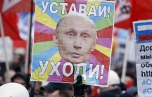 "Anti-government Russian demonstrators took to the streets in Decembe, 2011, increasing pressure on Vladimir Putin as he sought a new term as Russian president. The placard reads ""Get tired! Leave!"""