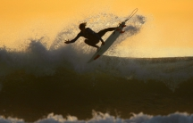 Surfing on the California coastline at dusk in Cardiff.