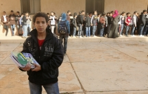 A Libyan student stands with newly received textbooks in Benghazi on January 18, 2012.