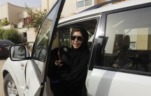 Female driver Azza Al Shmasani alights from her car after driving in defiance of the ban in Riyadh June 22, 2011.
