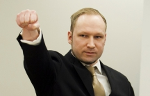 Norwegian mass killer Anders Behring Breivik gestures as he arrives for his terrorism and murder trial in a courtroom in Oslo April 16, 2012.