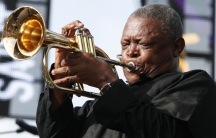 South African trumpeter and musician Hugh Masekela performs on May 13, 2012.