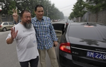 Chinese dissident artist Ai Weiwei, at left, poses outside his studio for a photograph with his lawyer, Pu Zhiqiang, in July 2012.
