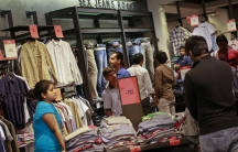 People shop for clothes during a seasonal sale at a store inside a shopping mall in Mumbai