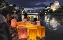 Hiroshima residents release paper lanterns on the Motoyasu river facing the gutted Atomic Bomb Dome in remembrance of atomic bomb victims on the 67th anniversary of the bombing.