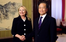 Chinese Premier Wen Jiabao and US Secretary of State Hillary Clinton shake hands at the Ziguangge Pavilion in the Zhongnanhai leaders' compound in Beijing on September 5, 2012.
