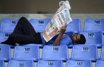 A Sri Lankan man reads the newspaper. People in Sri Lanka are most likely to read the paper in the mornings and evenings, the same times that disease-carrying mosquitoes come out to bite.