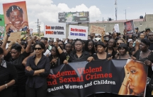 Jamaicans take part in a demonstration against the rape of three children and two women in Kingston in 2012.