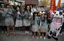 Students from a high school cheer for their seniors in front of a college entrance examination hall before the exam begins in Seoul, South Korea.