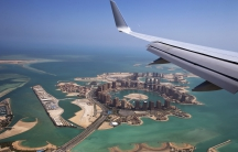 Airplane overlooking Doha.
