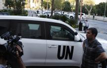 A U.N. convoy transporting a team of United Nations experts charged with starting the process of verifying and eliminating chemical weapons arrives at a hotel in Damascus on October 1, 2013.