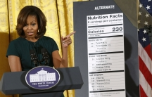 First Lady Michelle Obama unveils proposed updates to nutrition labels during remarks in the East Room of the White House on February 27, 2014.