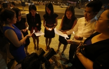 Malaysian ethnic Chinese sing songs as they hold a candlelight vigil for the passengers of Malaysia Airlines MH370 near Independence Square in Kuala Lumpur, Malaysia on March 10, 2014.
