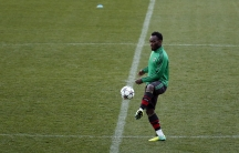 AC Milan's Michael Essien takes part in a training session at the Vicente Calderon stadium in Madrid on March 10, 2014, ahead of a UEFA Champions League match against Atlético Madrid.