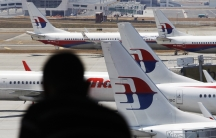 Malaysia Airlines planes sit on the tarmac at the Kuala Lumpur International Airport on March 11, 2014.