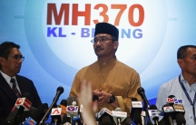 Malaysia's acting Transport Minister, Hishammuddin Tun Hussein, takes questions from journalists during a news conference about the missing Malaysia Airlines flight MH370.