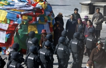 Chinese police patrolled outside Johkhang Monastery in the capital of the Tibet Autonomous Region of China in March 2014. Security forces always go on high alert around the sensitive March 10th anniversary.