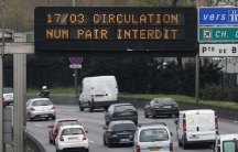"""An electronic sign above a Paris highway on March 17 reads """"Road traffic forbidden for even-numbered license plates."""" Public transportation was free and drivers of cars with even-numbered license plates faced fines as authorities sought to reduce air poll"""
