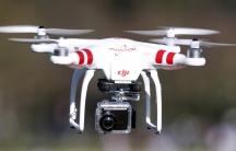 A Phantom drone by DJI flies during the 4th Intergalactic Meeting of Phantom's Pilots in western Paris in March 16, 2014.