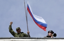 The Russian flag being hoisted over a Ukrainian naval facility in the Crimean city of Sevastopol, after the base was forcefully occupied, Wednesday.