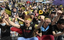 Demonstrators shout slogans in front of the Presidential Office in Taipei on March 30, 2014. Thousands of demonstrators marched the streets to protest against the controversial trade pact with mainland China.
