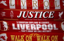 Liverpool scarves, including one asking for justice for the victims of the Hillsborough disaster, are seen for sale on a stall outside Anfield Stadium in Liverpool, England.