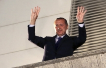 Turkey's Prime Minister, Recep Tayyip Erdogan, greets his supporters in Ankara after his AK party won a clear victory in municipal elections.