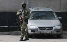 A pro-Russian armed man stands guard on a street in Slavyansk, in the Donetsk region of eastern Ukraine. Professional-looking troops with specialized Russian weapons but no insignia are spreading across eastern Ukraine.
