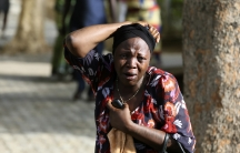 Abuja residents react as victims of a bomb blast arrive at a local hospital this week.