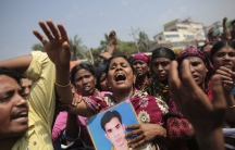 Relatives of victims killed in the collapse of Rana Plaza mourn on the first year anniversary of the accident. More than 1,100 factory workers were killed when the garment factory complex the worked in collapsed.  Today, the owner of the building was char