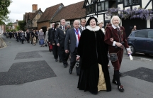 Dressed as William Shakespeare and his wife Anne Hathaway, John and his wife Monica Evans join a procession to Holy Trinity Church where Shakespeare was buried, marking the 450th anniversary of his birth in 2014