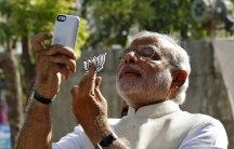 """Hindu nationalist Narendra Modi, the prime ministerial candidate for India's main opposition Bharatiya Janata Party (BJP), takes a """"selfie"""" after casting his vote at a polling station during the seventh phase of India's general election."""