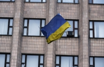 A Ukrainian flag tumbles to the street, after being thrown by pro-Russian protesters from the top of a district council building in Ukraine.