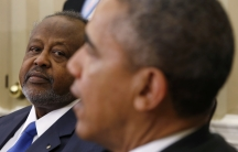 U.S. President Barack Obama meets with President Ismaïl Omar Guelleh of Djibouti on May 5, 2014. Some Djiboutians say American ties to their country are holding back democratization.